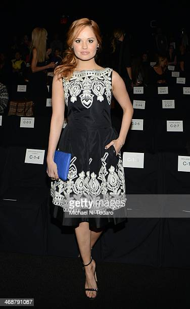 Debby Ryan attends the Naeem Khan Show during MercedesBenz Fashion Week Fall 2014 at The Theatre at Lincoln Center on February 11 2014 in New York...