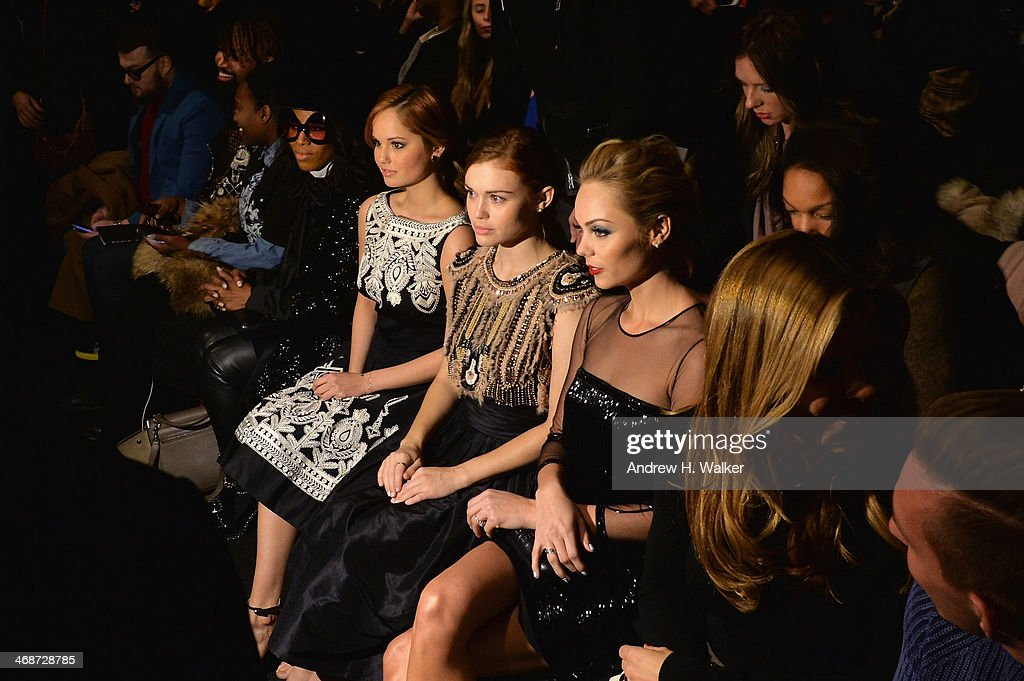 Debby Ryan, Holland Roden and Laura Vandervoort at the Naeem Khan show during Mercedes-Benz Fashion Week Fall 2014 at Lincoln Center for the Performing Arts on February 11, 2014 in New York City.