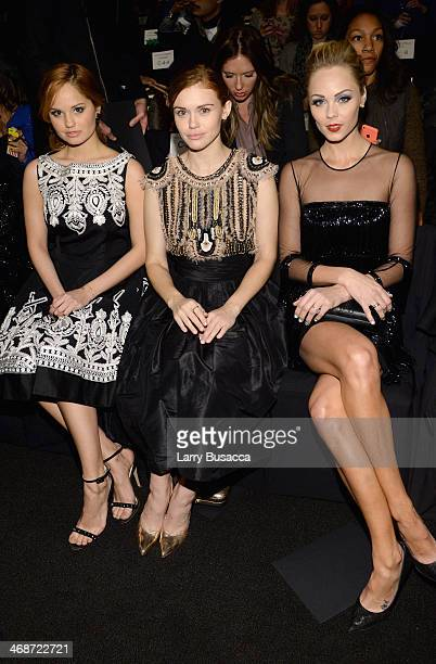Debby Ryan Holland Roden and Laura Vandervoort attend the Naeem Khan fashion show during MercedesBenz Fashion Week Fall 2014 at The Theatre at...