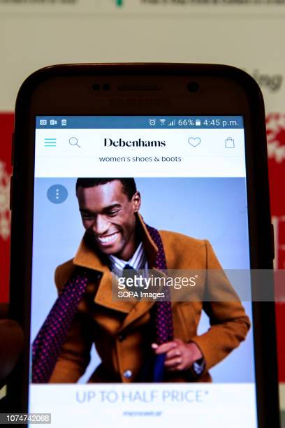 Debenhams Boxing Day online sale is seen on a mobile phone Boxing Day online sales has begun in many high street stores as shops try to make up for...