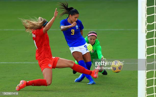 Debhina of Brazil scores a goal against Stephanie Labbe of Canada during the SheBelieves Cup at Exploria Stadium on February 24, 2021 in Orlando,...