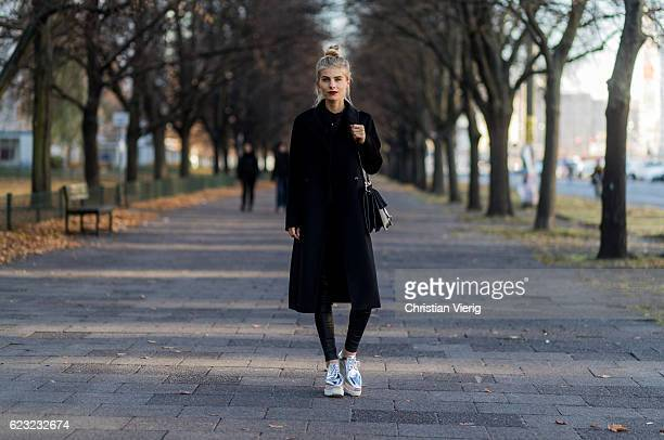 Debi Fluegge wearing a black Max Mara wool coat black Twist and Tango skinny pants silver Stella McCartney creepers shoes black Chloe bag black...