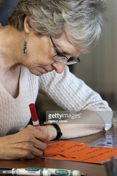 Debi Ham works on her 'conversation starter' as part of a letter exchange program with the Boston Children's Chorus in Boston on May 3 2018 For a...