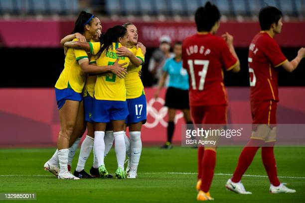Debinha of Brazil and Andressinha of Brazil celebrate their sides third goal during the Tokyo 2020 Olympic Football Tournament match between China...