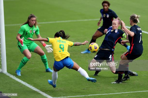 Debinha of Brazil attacks the net against Alyssa Naeher,Becky Sauerbrunn, Abby Dahlkemper and Crystal Dunn of United States during the first half of...