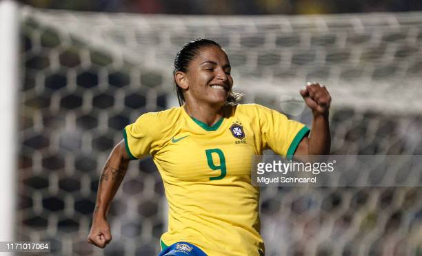 Debinha of Brazil celebrates after scoring her team's third goal during a match between Argentina and Brazil part of Uber International Cup 2019 at...
