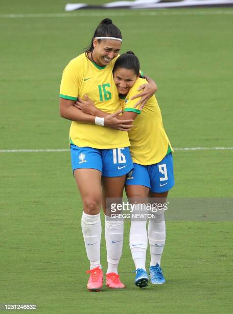 Debinha of Brazil celebrates with teammate Beatriz after scoring a second half goal during their game against Argentina at the SheBelieves Cup...