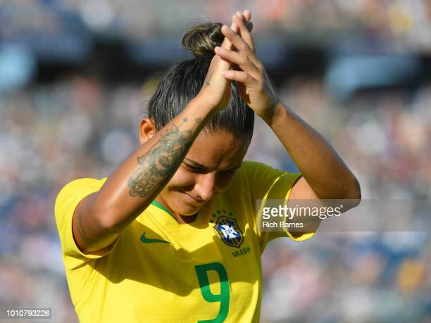 Debinha of Brazil gestures to fans while leaving the match against Japan during the second half of a Tournament of Nations game played at Pratt...