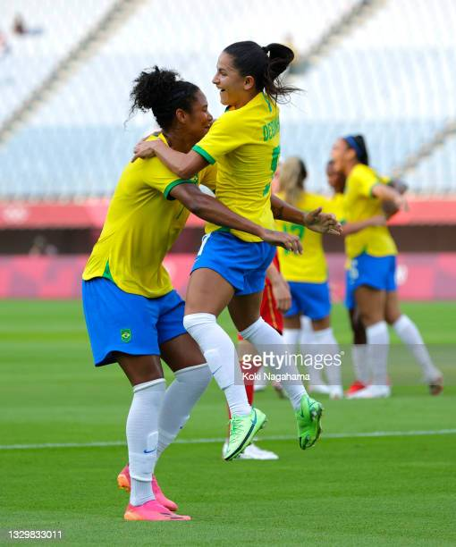 Debinha of Team Brazil celebrates with teammate Poliana after scoring their side's second goal during the Women's First Round Group F match between...