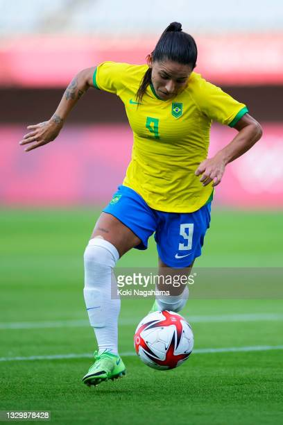 Debinha of Team Brazil runs with the ball during the Women's First Round Group F match between China and Brazil during the Tokyo 2020 Olympic Games...