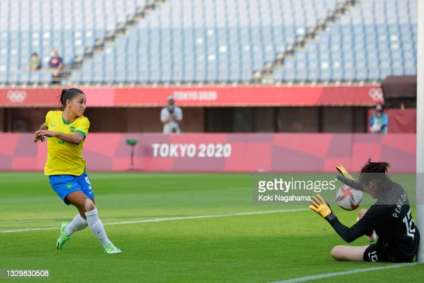 Debinha of Team Brazil scores their side's second goal past Shimeng Peng of Team China during the Women's First Round Group F match between China and...