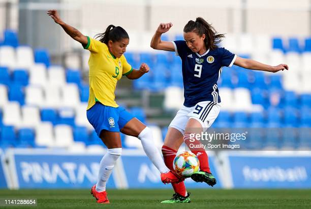 Debinha Oliveira of Brazil competes for the ball with Caroline Weir of Scotland during the Women's International friendly match between Brazil and...