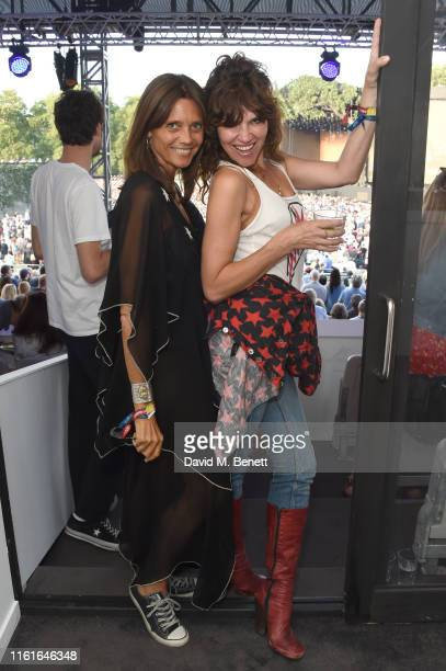 Debonnaire von Bismarck and Jess Morris attend the Teen Cancer America Suite at Bob Dylan and Neil Young in Hyde Park on July 12 2019 in London...