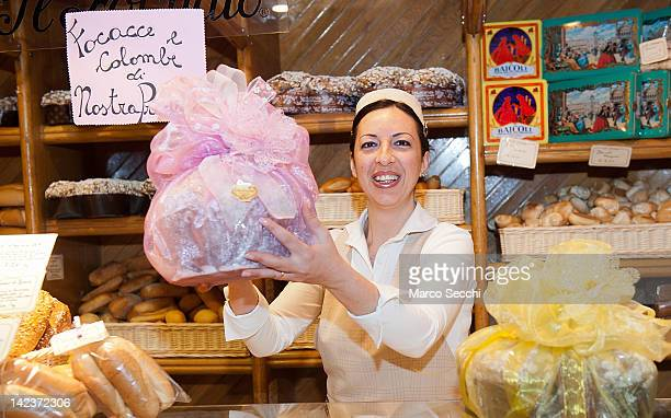 Debora a sale assistant at Colussi Bakery holds a Colomba traditional Easter cake on April 3 2012 in Venice Italy The Italian bakery Colussi...
