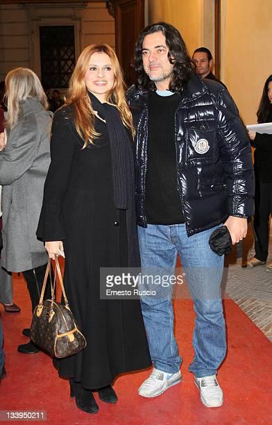 """Debora Caprioglio and Angelo Maresca attend the """"Eroine Di Stile"""" Opening Exhibitionon at Palazzo Altemps on November 22, 2011 in Rome, Italy."""