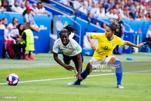 Debora de Oliveira Debinha of Brazil battles for the ball with Viviane Asseyi of France during the 2019 FIFA Women's World Cup France Round Of 16...