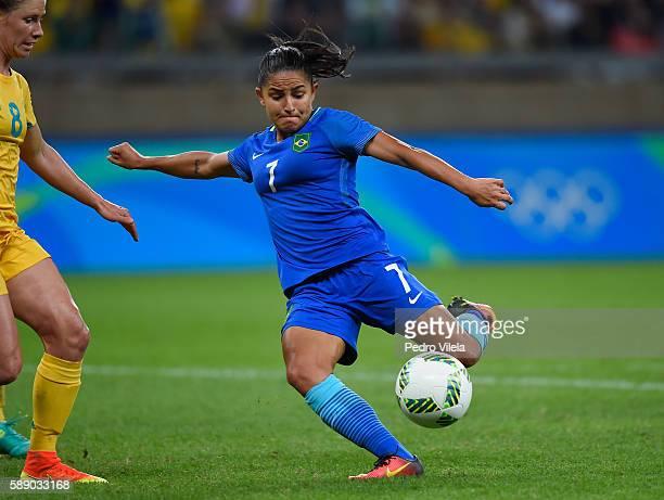 Debora of Brazil kicks the ball against Elise KellondKnight of Australia during the second half of the Women's Football Quarterfinal match at...