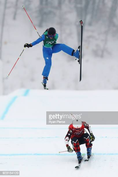 Debora Pixner of Italy crashes with Brittany Phelan of Canada during the Freestyle Skiing Ladies' Ski Cross 1/8 Finals on day fourteen of the...