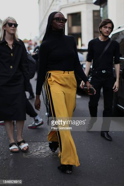 Deborah Ababio is seen wearing a Pair of Yellow Track Bottoms at Richard Quinn, during London Fashion Week September 2021 on September 21, 2021 in...