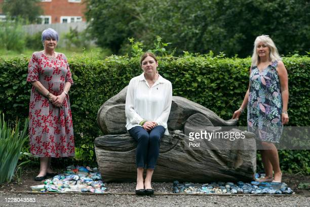 Deborah Adlam mother of PC Andrew Harper alongside Debor Baldree and Wendy Harriss who corun Reading Kindness Rocks next to a memorial for the police...