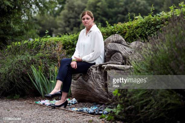 Deborah Adlam mother of PC Andrew Harper sits next to her son's memorial near Reading Berkshire after attending a service to mark the first...