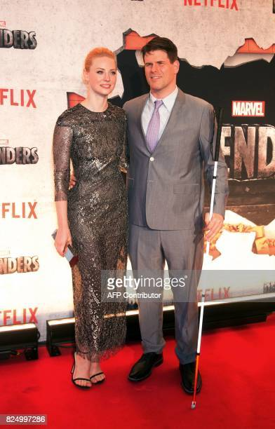 Deborah Ann Woll and EJ Scott arrive for the Netflix premiere of Marvel's 'The Defenders' on July 31 2017 in New York / AFP PHOTO / Bryan R Smith