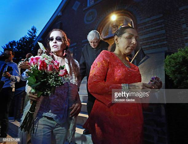 Deborah Costa left and Yolanda Costa the aunts of the pregnant woman who was stabbed the Holy Family Catholic Church after a vigil for the victims of...