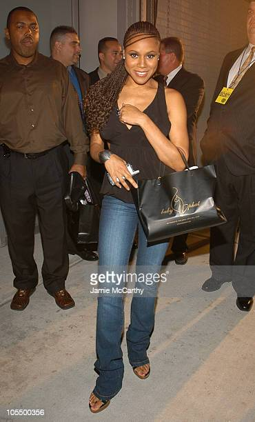 Deborah Cox during Olympus Fashion Week Spring 2005 Baby Phat Front Row at Skylight Studio in New York City New York United States
