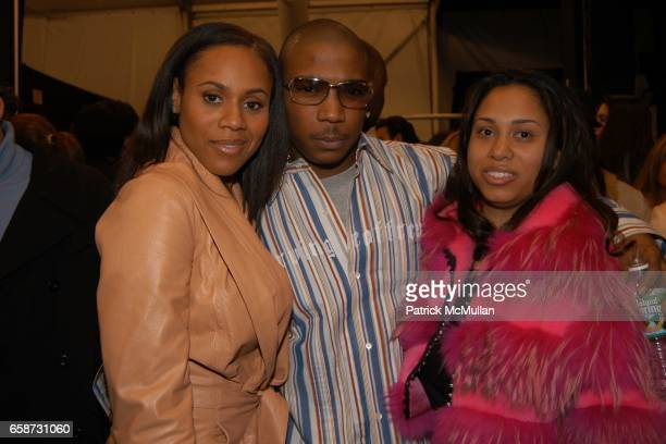 Deborah Cox JaRule and Aisha Atkins attend the Luca Luca Fashion Show at The Tent Bryant Park on February 8 2004 in New York City