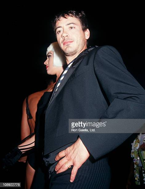 Deborah Falconer and Robert Downey Jr during Jean Paul Gaultier Fashion Show to Benefit AmFar September 24 1992 at Shrine Auditorium in Los Angeles...