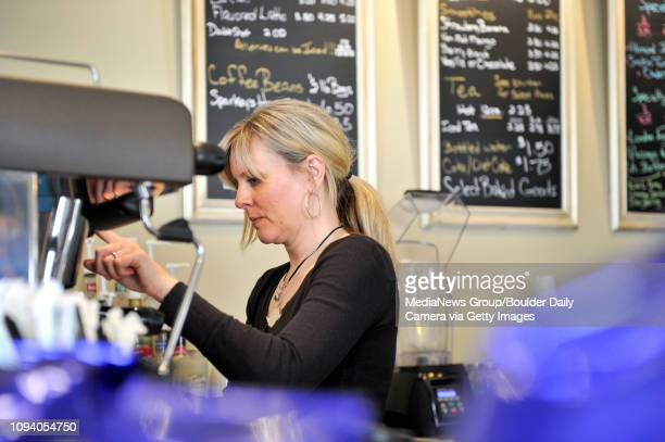Deborah Flanagan makes a drink for a customer Friday May 3 at Carbon Valley Coffee Roasters in Frederick