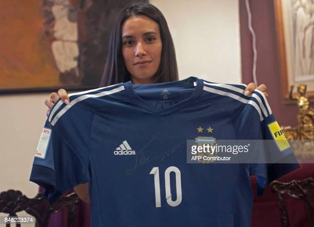 Deborah Gignac wife of French footballer Andre Pierre Gignac shows Argentine footballer Lionel Messi's autographed jersey to be auctioned in...
