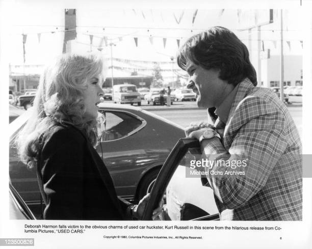 Deborah Harmon falls victim to the charms of Kurt Russell in a scene from the film 'Used Cars' 1980