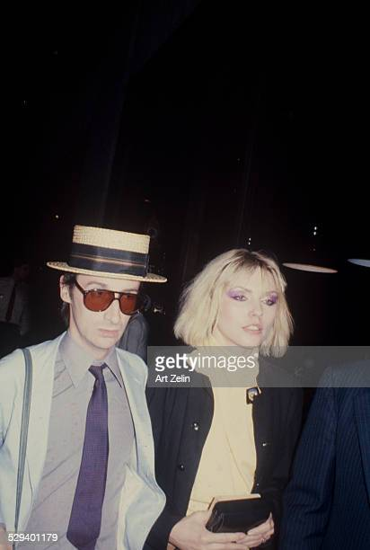 Deborah Harry with her partner Chris Stein She is wearing a yellow sweater he is wearing a straw hat circa 1970 New York