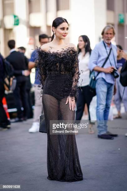 Deborah Hung wears a black lace mesh fluffy dress outside Fendi during Paris Fashion Week Haute Couture Fall Winter 2018/2019 on July 4 2018 in Paris...