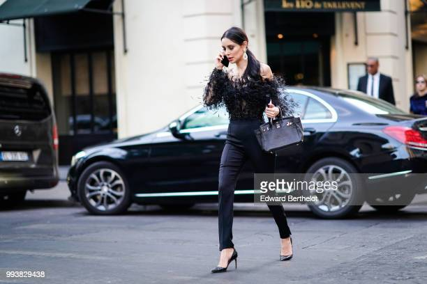 Deborah Hung wears a black lace mesh top black jeans outside Valentino during Paris Fashion Week Haute Couture Fall Winter 2018/2019 on July 4 2018...