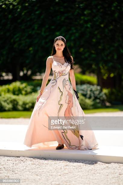 Deborah Hung wears a pink dress with printed drawings outside Dior during Paris Fashion Week Haute Couture Fall Winter 2018/2019 on July 2 2018 in...