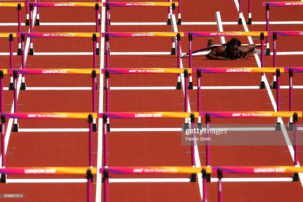 Deborah John of Trinidad and Tobago falls as she competes in the Women's 100 metres hurdles heats during day eight of the 16th IAAF World Athletics Championships London 2017 at The London Stadium on August 11, 2017 in London, United Kingdom.