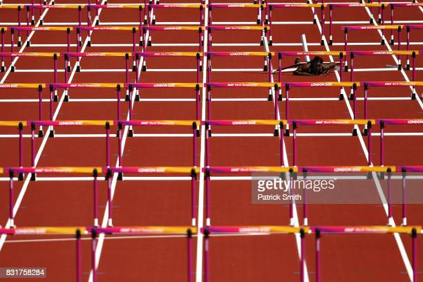 Deborah John of Trinidad and Tobago falls as she competes in the Women's 100 metres hurdles heats during day eight of the 16th IAAF World Athletics...