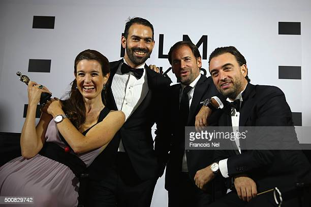 Deborah Jossa poses with a guest Adrian Jossa and the owner of The Clinic Karim Fekih during the IWC Filmmaker Award Night 2015 at The One Only Royal...