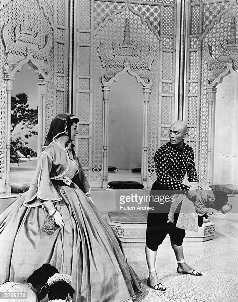 Deborah Kerr as the governess is being introduced to the children of the palace by Yul Brynner who is playing their father the King of Siam in a...