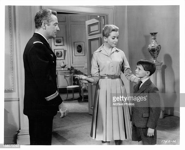 Deborah Kerr introduces Martin Stephens to his long absent father Rossano Brazzi in a scene from the film 'Count Your Blessings' 1958