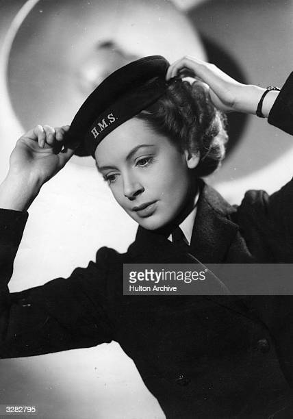 Deborah Kerr the screen name of Deborah KerrTrimmer the British leading lady adjusting her hat in a scene from 'Perfect Strangers' directed by...