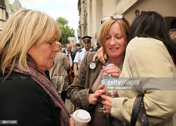 Deborah Kinsella mother of murdered school boy Ben Kinsella is consoled by a friend outside the Old Bailey as actress Linda Robson looks on on June...