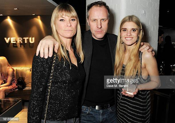 Deborah Leng Simon Mills and Tiger Lily Taylor attend the launch of the Vertu Ti at the London Film Museum Covent Garden on February 12 2013 in...