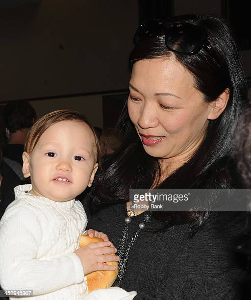 Deborah Lin and daughter Liliana Ruth Gandolfini attend the James Gandolfini street naming ceremony on December 1 2013 in Park Ridge New Jersey