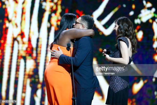 Deborah Lukumuena receives the Cesar of Best supporting actress in 'Divines' from Joey Starr and Anna Mouglalis during the Cesar Film Awards Ceremony...