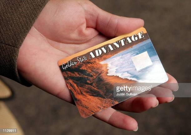 Deborah McFadden holds a sample of the new California State Electronic Benefit Transfer card July 17 2002 in Oakland California On August 1 Alameda...