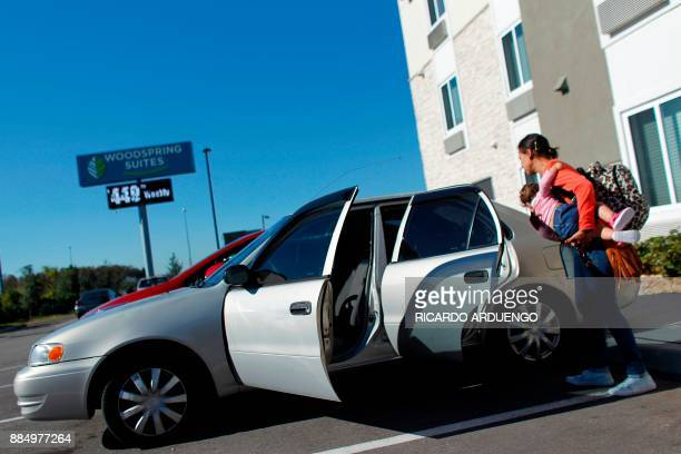 Deborah Oquendo boards her 10mo old daughter Genesis Rivera into her car at the hotel were they are staying in Orlando Florida on December 1 2017 On...
