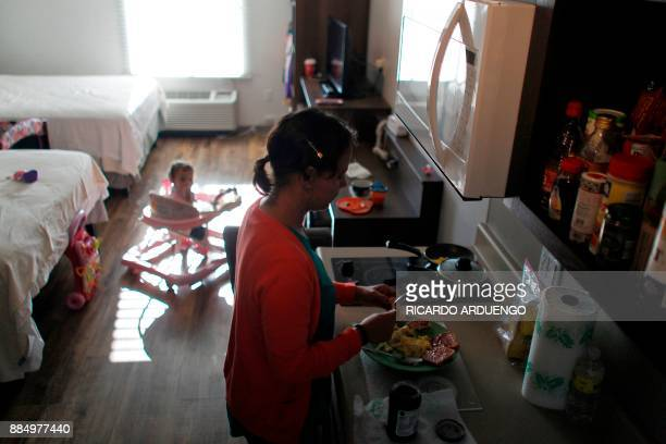 Deborah Oquendo prepare breakfast for her and her 10mo old daughter Genesis Rivera at the hotel were they are staying in Orlando Florida on December...